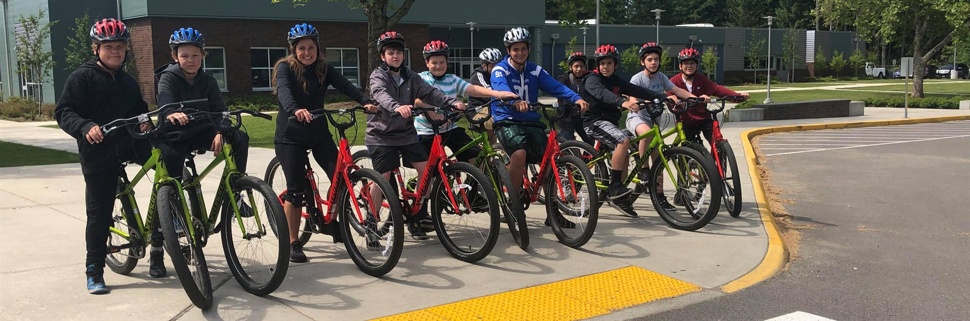 Hawkins students riding new bikes from a special grant.