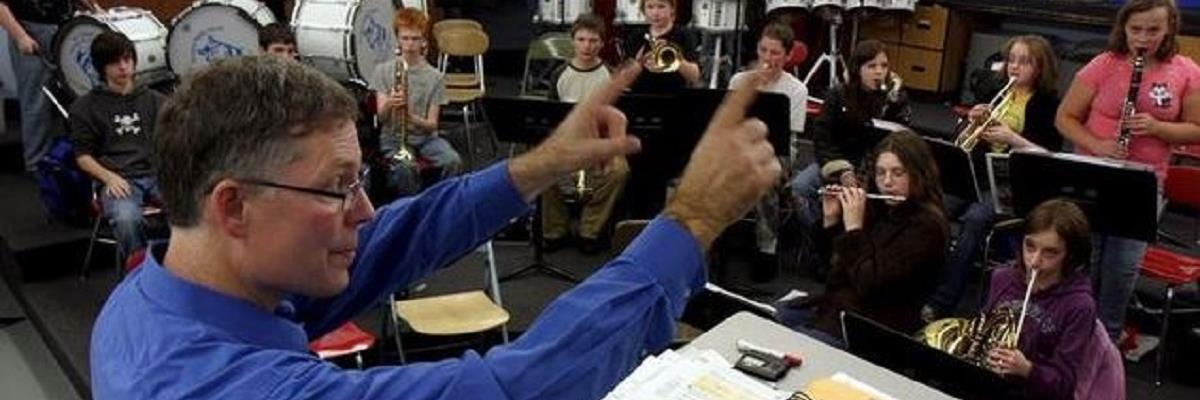 Candid photo of Mr. Yantis getting his Hawkins Middle School band class ready to play.