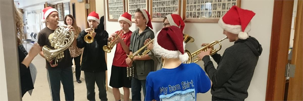 Seven middle school student brass section play a winter holiday tune at the North Mason School District Office