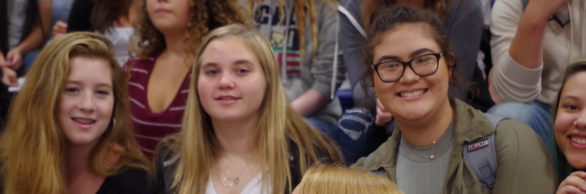 NMHS students smiling at the welcome back assembly.
