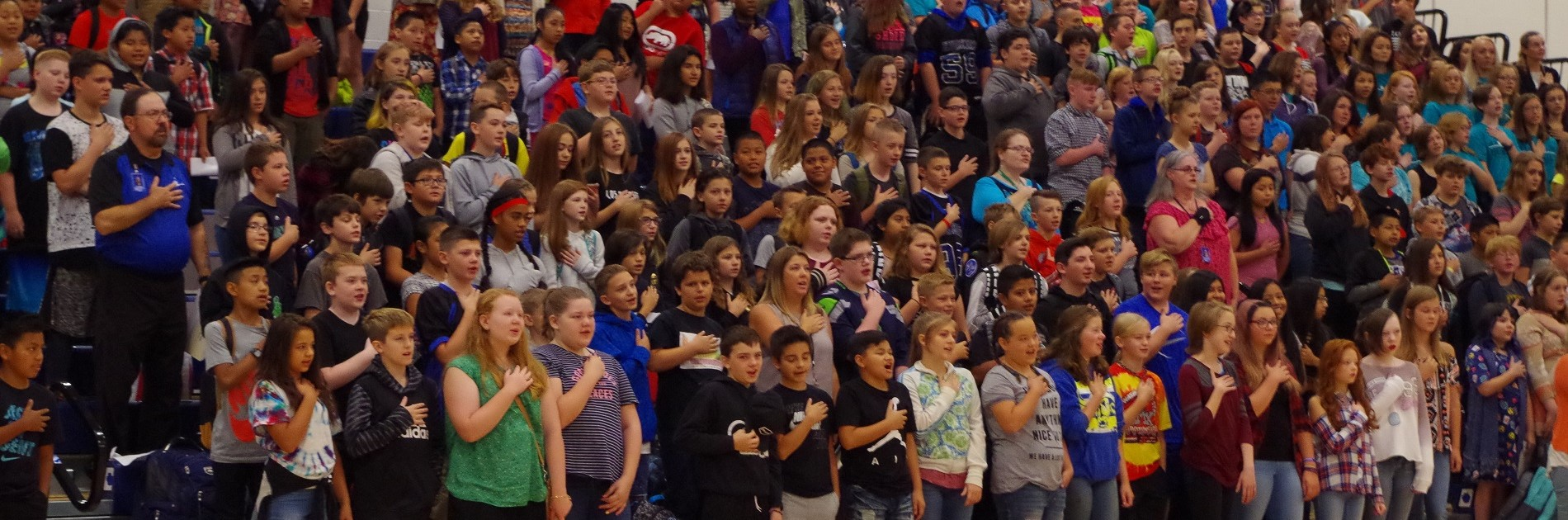 Hawkins students stand for the Pledge of Allegiance.