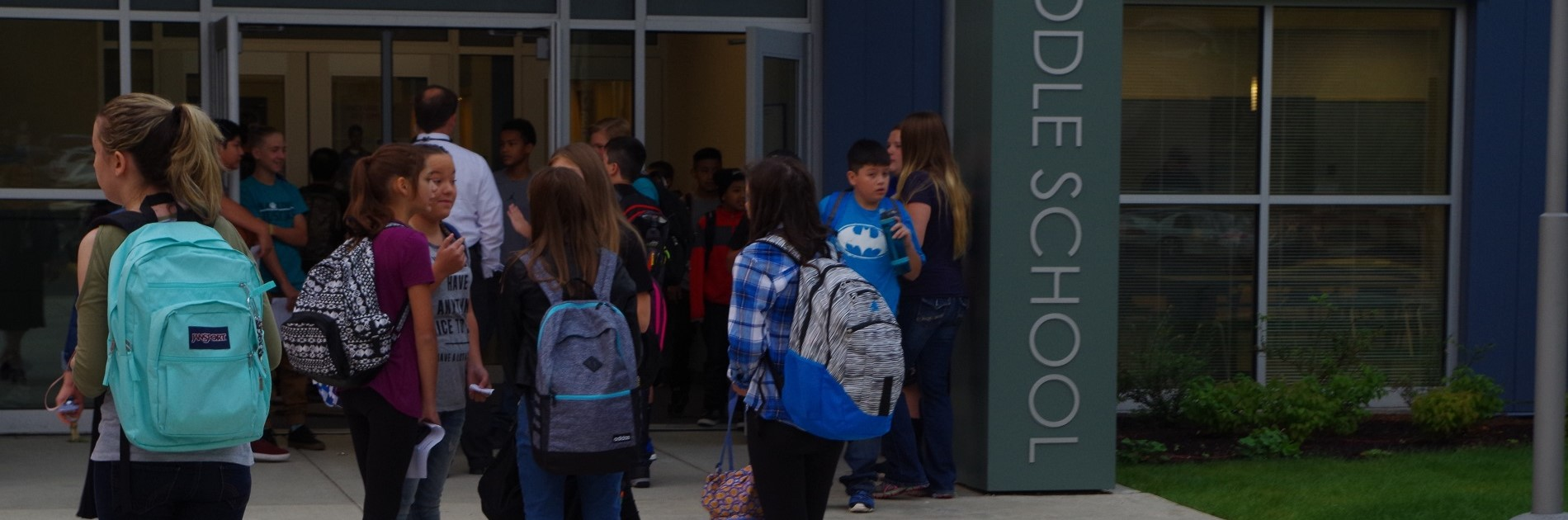 Hawkins students entering the school on their first day of school.