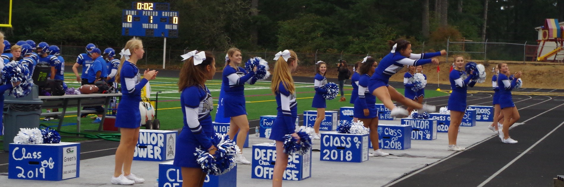 Cheerleaders lead the crowd in cheers from the sidelines.