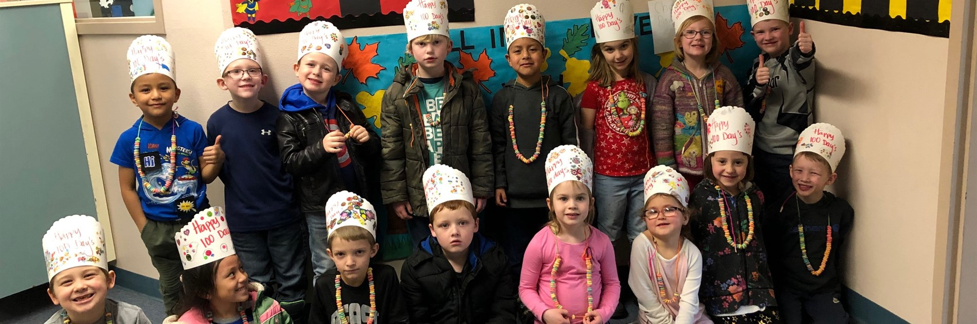 Students wearing Day 100 hats they made
